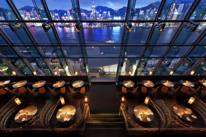 Ozone, Hong Kong, China - The highest bar in Hong Kong has one hell of a view. Look down from the 118th floor of the five star The Ritz Carlton Hotel and marvel at the city lights way down below while sipping on cocktails. You're sitting almost in the stars up here so the décor is appropriately other worldly, with psychedelic lighting, tessellated marble floors, honeycombed wall art and globular sculptures. The windowside tables are hot property so head up early and settle in.