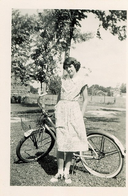 Kay, in 1948, on her first day of 7th grade. Cotton dress, saddle shoes and a cruiser bike. She would have been the girl I wanted to be friends with at school.