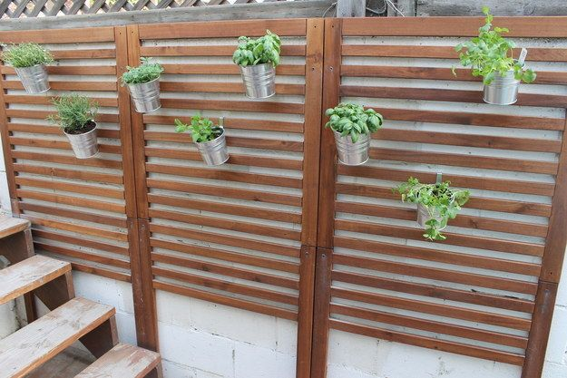 Make an outdoor wall o' greenery using Äpplarö wall panels and Socker planters. | 19 Incredibly Clever Ways To Use Ikea Products As Your Garden