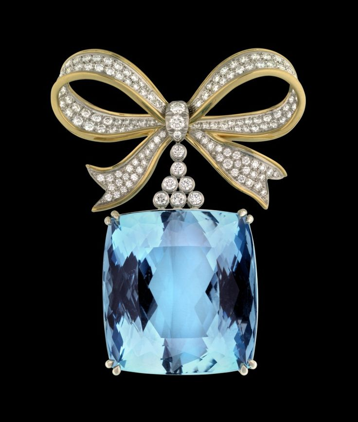 Jean Schulmberger for Tiffany & Co - like the  iconic Tiffany blue box all wrapped up with bow!
