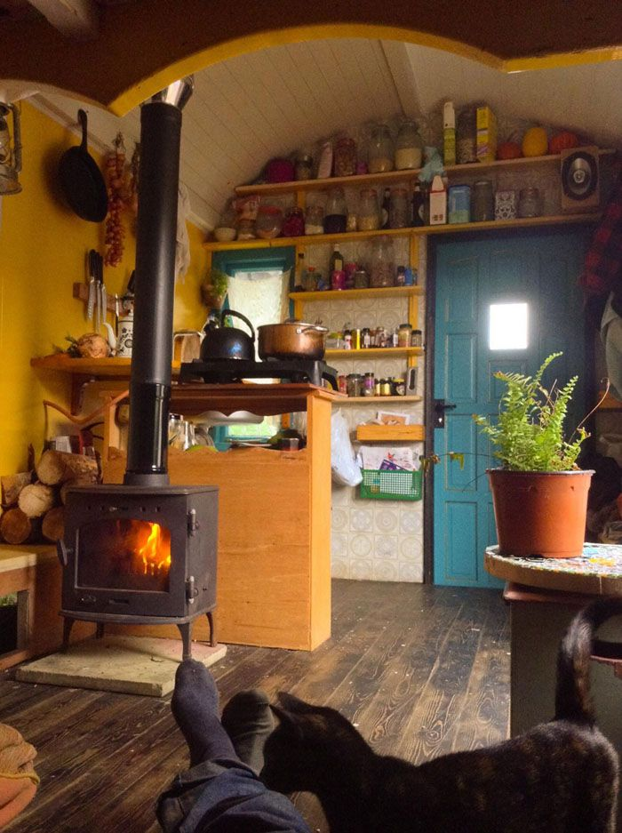 The dark wood floor and the central woodstove remained constants.  #TinyHouseforUs