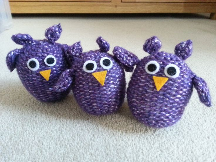 I knitted this family of owls for my sister using a circular hoop with pins sticking up, and weaving the wool as in basket making. The ear feather tufts and wings were made on a smaller hoop. The eyes and beaks were cut out of felt and glued on. Each owl is stuffed with toy stuffing with a sachet of lavender in the centre, made from dried lavender sewn into a small scrap of material. They smell wonderful and are perfect for sock drawers.