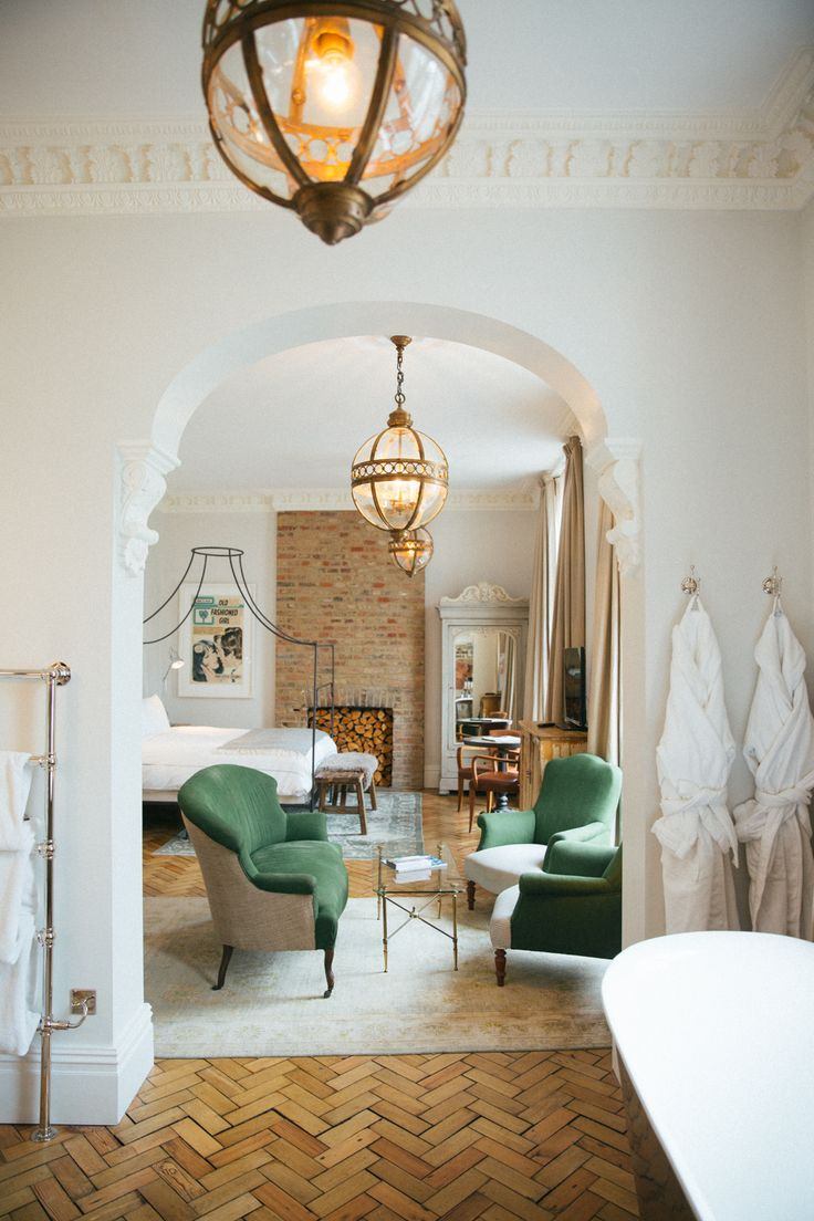 Green sofas and arched doorways