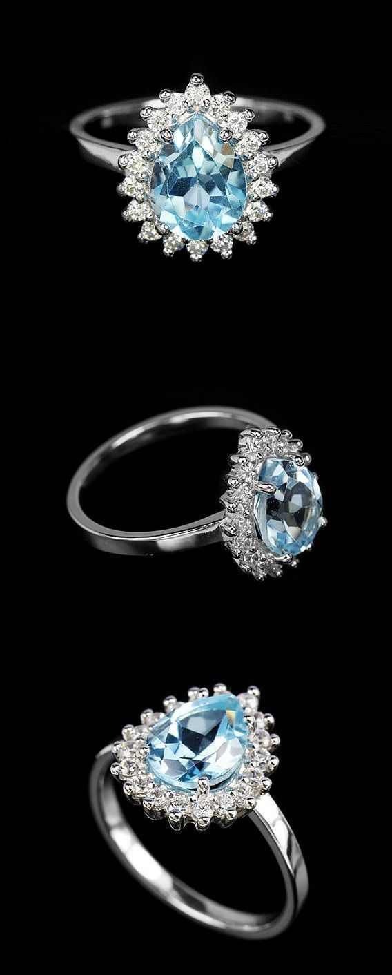 Blue Topaz Ring, November Birthstone Ring, Blue Stone ring, Pear Ring, White Halo ring, Princess Ring, Anniversary Ring, Push Present  This is a delicate and elegant silver ring with Genuine blue topaz gemstone in pear cut shape. It is made from 925 Sterling Silver and 14K White Gold Plated. The charm of this ring is in art deco princess style halo in white CZ framing teardrop blue topaz. It is an elegant ring which would be perfect for engagement or promise ring or any other fitting…