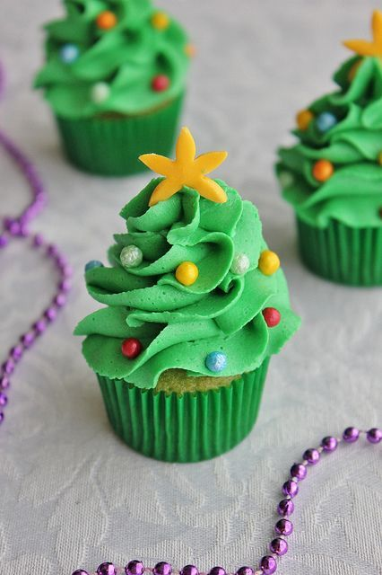 Mini Christmas Tree Cupcakes...I would undoubtedly make a disaster out of these, but they are stinking cute!