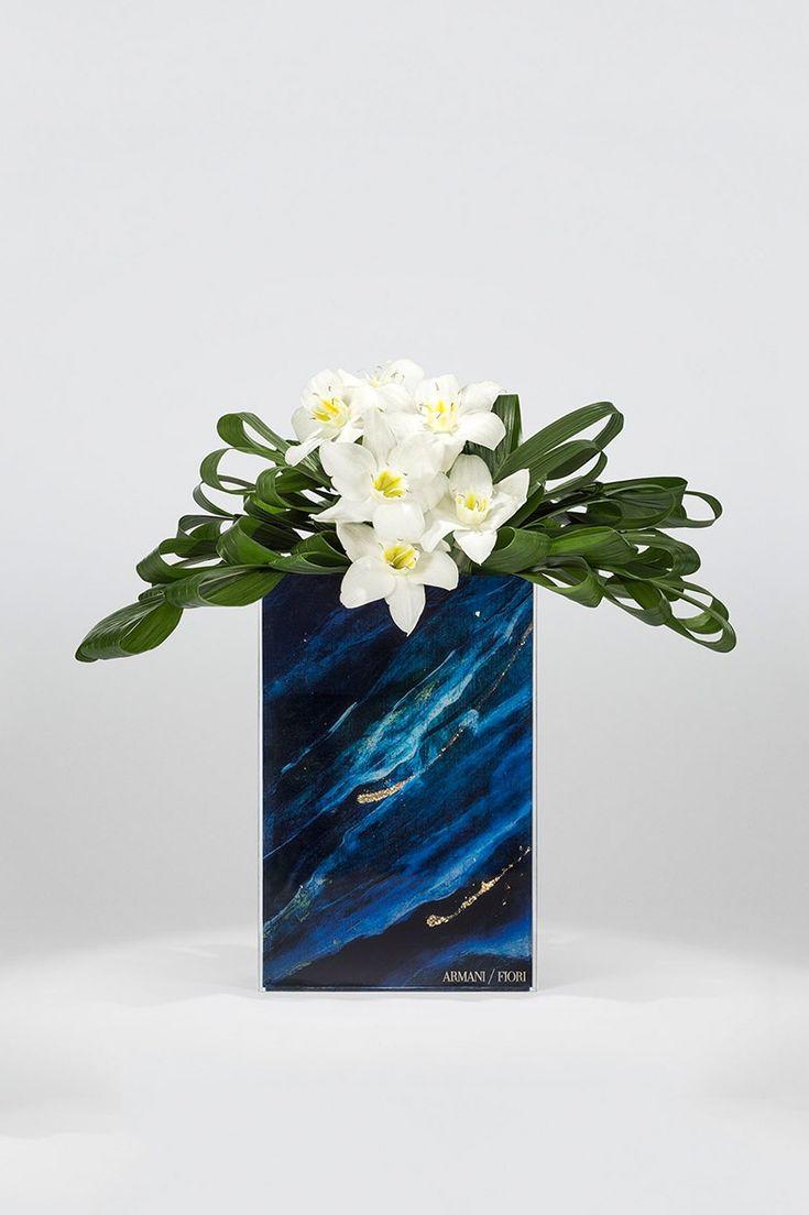 Eucharis and coconut leaves on blue night plexiglass vase Armani Flowers