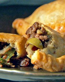 Beef empanadas .--~~>Empanadas are a popular street food and fun to re-create in your own kitchen. These empanadas have a hearty beef and vegetable filling encased in tender cream cheese pastry crust.