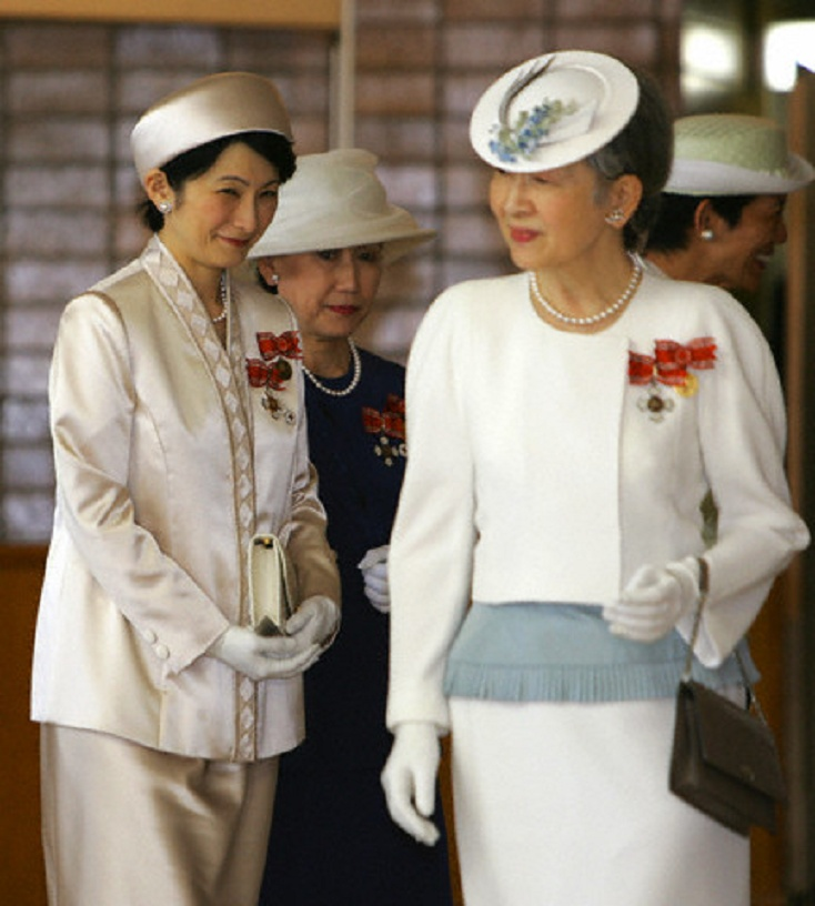 Japanese Princess Kiko (L), wife of Emperor Akihito's second son Prince Akishino with Empress Michiko (R) as they leave a general meeting of the Japanese Red Cross Society in Tokyo