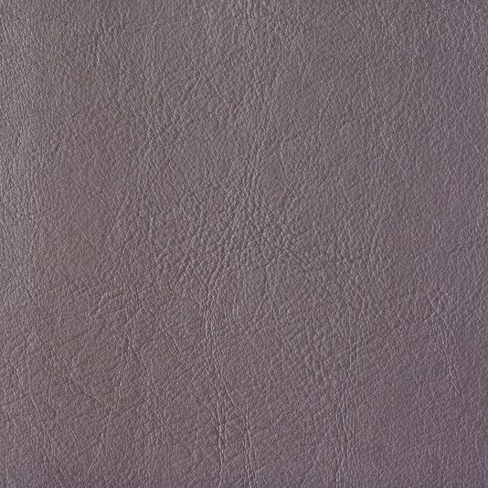 Orzan Faux Leather Upholstery Fabric Faux leather upholstery fabric in Grape. Suitable for Domestic and Contract upholstery.
