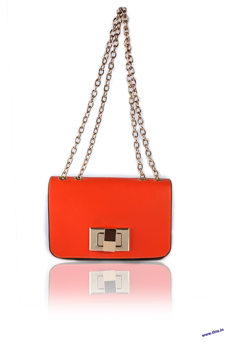 Sleek Orange Cross Body -   Body Crafted In Leather Look Fabric, Long Line Chain Shoulder Strap, Fold Over Flap with a Gold-Tone Twist Lock Fastening, Zipped Compartments in The Lining, Secured Body Through Zip Mouth Opening, Hardware In Gold........ - Rs. 1,250.00