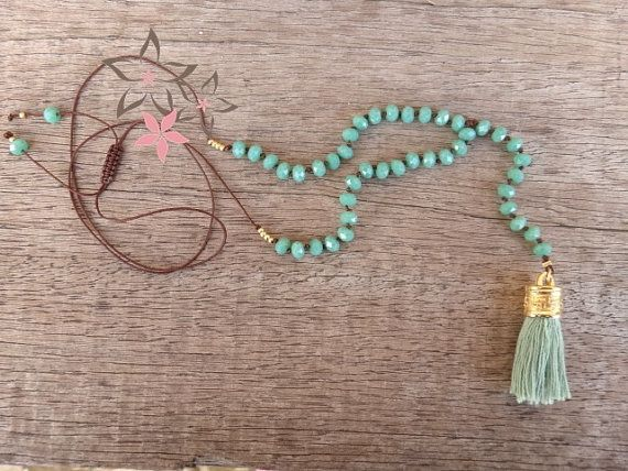 Handmade rosary necklace with green opaque crystal stones on silk cord adorned with a silk tassel in mint color at the edge and brass cap.  You can wear