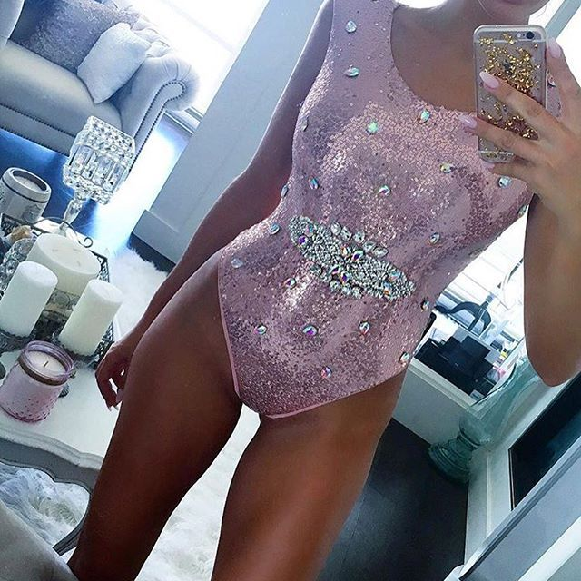 """Our """"Showstopper"""" swimsuit is to die for ! Stunning rose sequinned swimsuit with crystal sash and teardrop crystal sprinkles ! Zipper back and cheeky cut bum  SHOP THE LOOK  Www.HOUSEOFSMOOCH.COM  #abikiniaday #swarovski #luxurylifestyle #luxuryswimwear #luxe #swimwear #swimsuit #bikinis #smoochswimwear #crystalbikini #trending #fashion #sale #shopping #bikinisale #bikinifitness #fitness #lingerie #boudoir #pagent"""