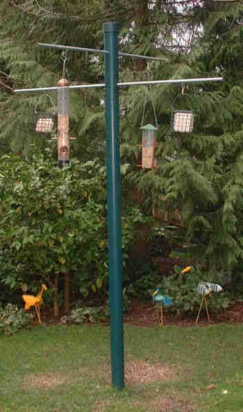 """Chris made this.   He used 2"""" pvc pipe instead.  I painted it a light green.  So far so good!  He also made a wooden one with copper pipe...but squirrels can master it.  So we hang squirrel proof feeders from that one.  Fun!"""