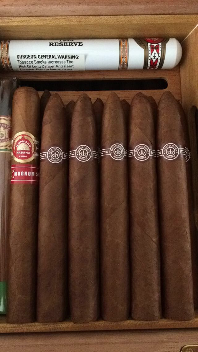 Humidor stocked with Cubans. Montecristo #2 and H.Upmann #humidor #cubans #cigars