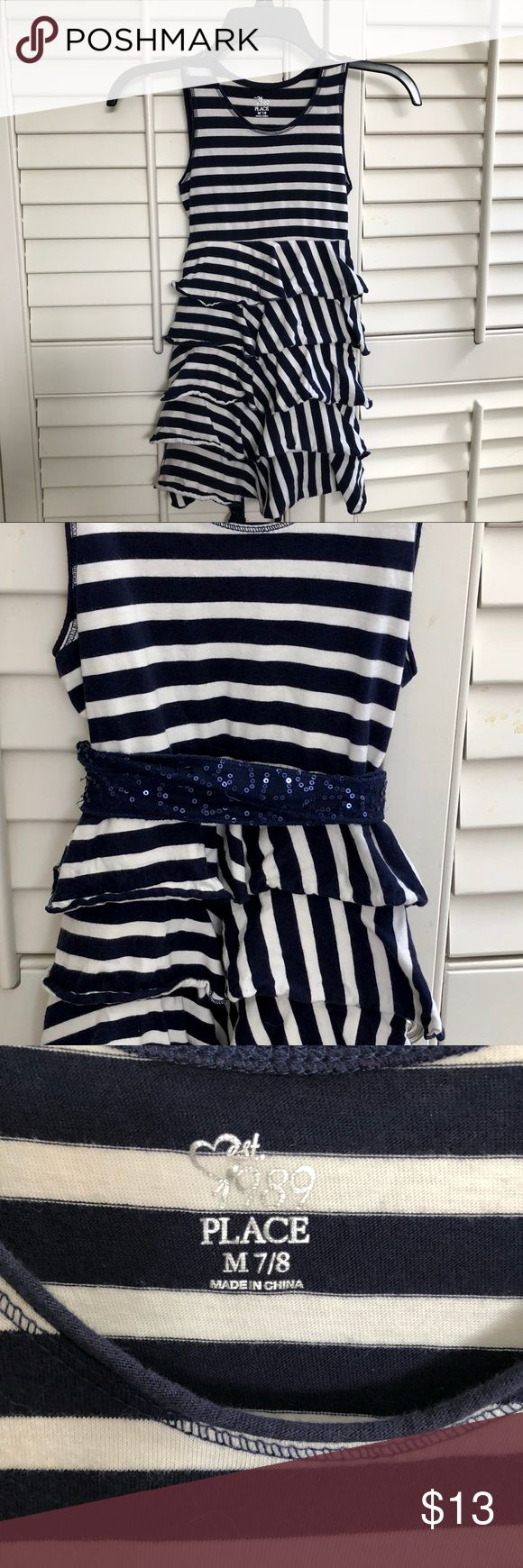 Adorable blue & white striped dress w/sash. SZ 7/8 From The Children's Place...perfect summer dress with a blue & white nautical look. Comes with a navy sequin sash you can tie in the front or back (see photos)...or go without it for a more casual look😀. With the ruffled bottom-it has enough style on its own! SZ 7/8. Selling for a friend...I don't see any flaws whatsoever!! The Children's Place Dresses Casual
