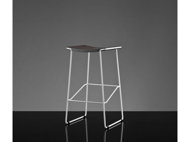 Wrap Stool is a simple, sophisticated design. The name derives from the way the bent steel rod and the plywood seat top 'embrace' each other around the edge of the seat. Three heights and various c…