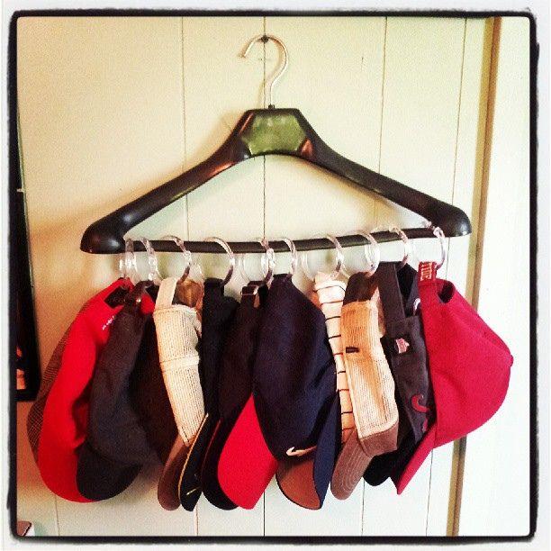 1 Coat Hanger + 10 Shower Curtain Hooks = Super Space-Saving Hat Storage! (via Pinterest)   Flickr - Photo Sharing!