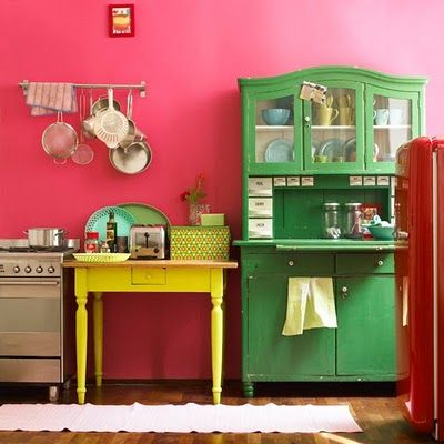 Solid colors mesh odd furniture pieces together. Exactly what I'd like to do in the play room with mismatched shelves.