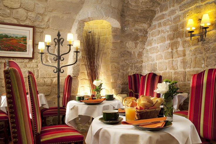 The beautiful vaulted exposed brick walled dining room at Hotel Saint Paul Rive Gauche, an amazing blend of old-and-new #designinspiration #hotel #Paris