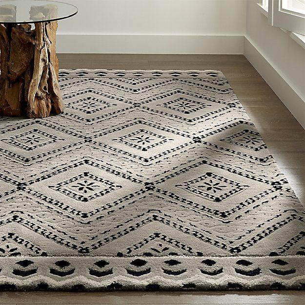Inspiration from Mediterranean Majorca tiles, designer Mariella Ienna creates a true work of art in the Odelia rug. Soft New Zealand wool in a subdued off white and blue palette is tufted in loop and cut piles to add a subtle high/low texture to the rug's sophisticated diamond grid motif.