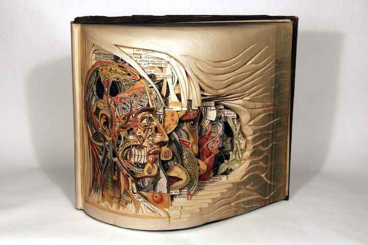 The Book Surgeon, Brian Dettmer, carves one page at a time. There are 15 of his sculptures at this link.