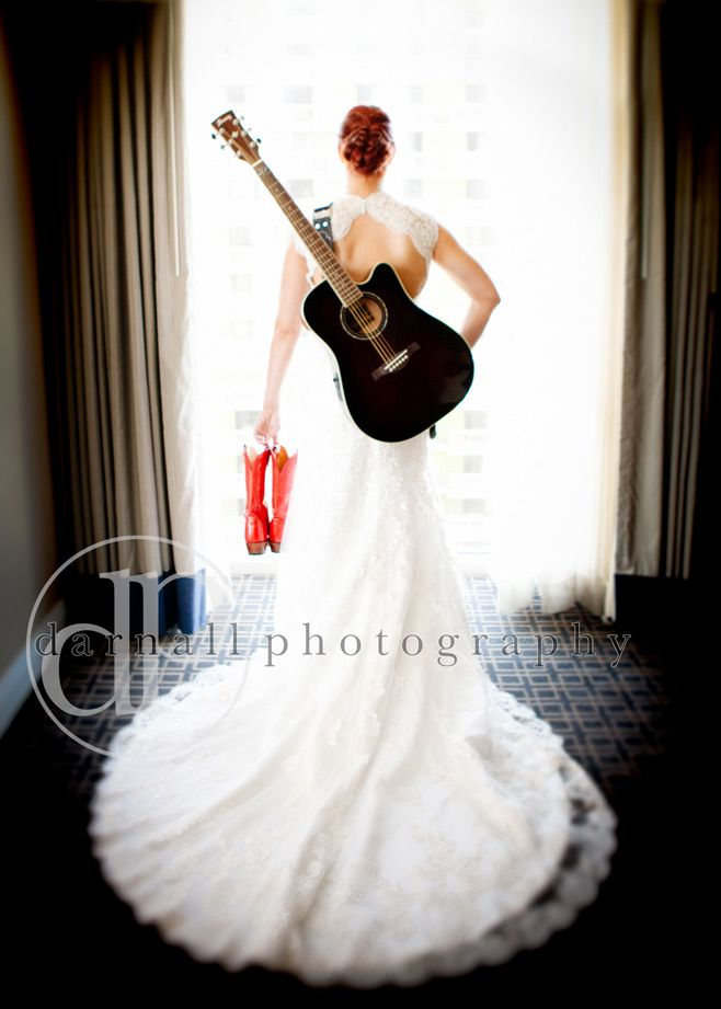 Awesome Photo! Black guitar, White dress, Red cowgirl boots. \\ Photo Credit: Darnall Photography #rockinwedding #redwedding #roguebride