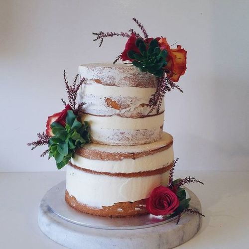 2 tier naked cake with white buttercreme, succulents & roses. Rustic theme