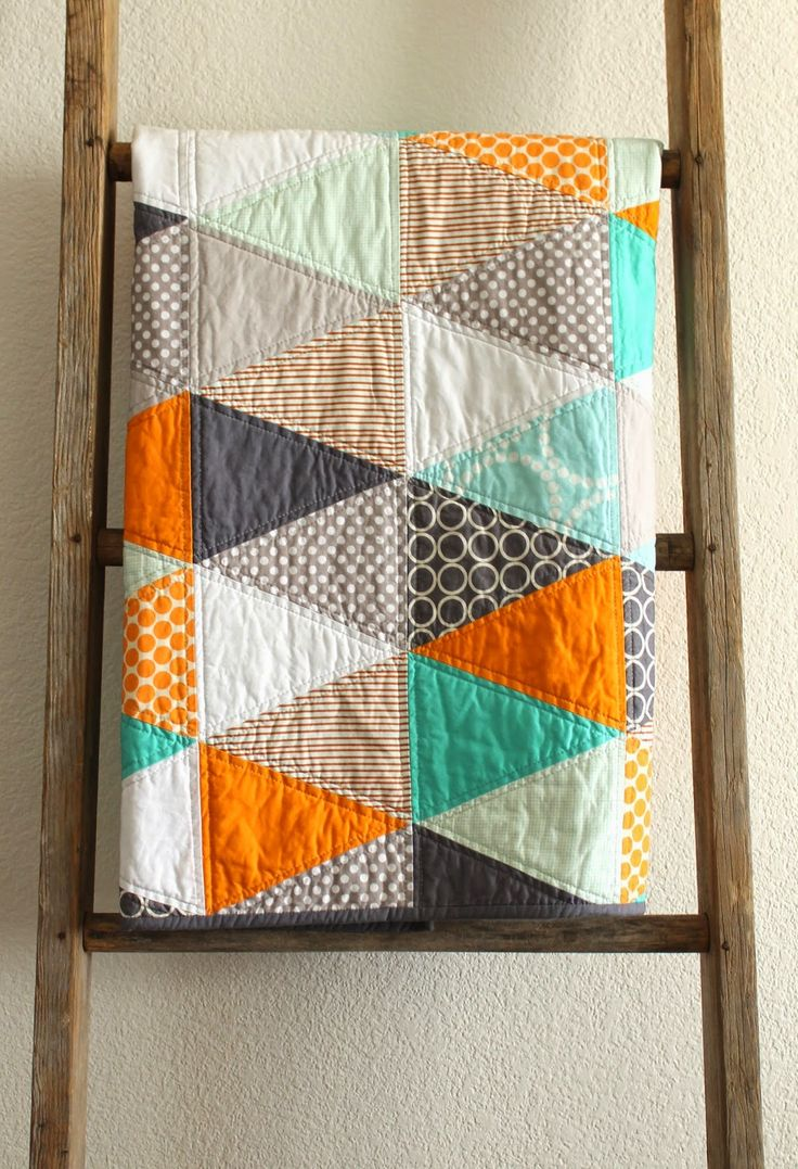 craftyblossom: orange and aqua isosceles triangle quilt.
