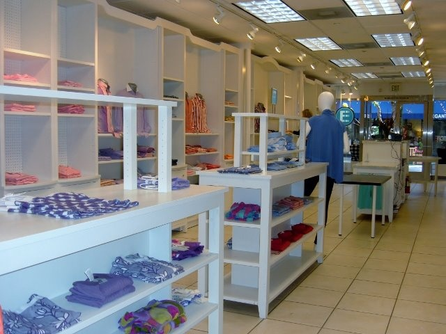 The store lay out is beautiful white with colorful shirts throughout.