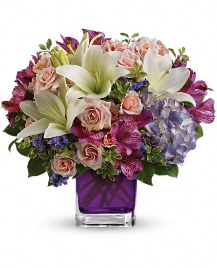 Teleflora's Garden Romance Bouquet - gorgeous array of pink, purple, lavender and white flowers in a purple cube vase.