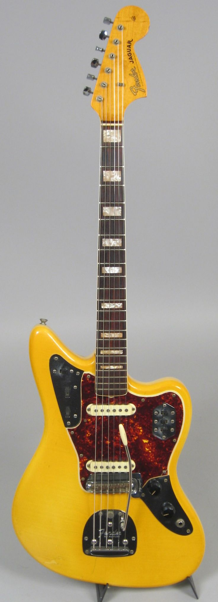 1966 Fender Jaguar. Blonde, but the lacquer has yellowed with age, making it really YELLOW. Wow. NEVER seen one like this before. I don't like yellow, as a rule, but it just works here.