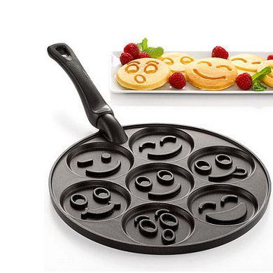 Start your day smiling with this smiley face pancake pan! Where was this when we were kids?