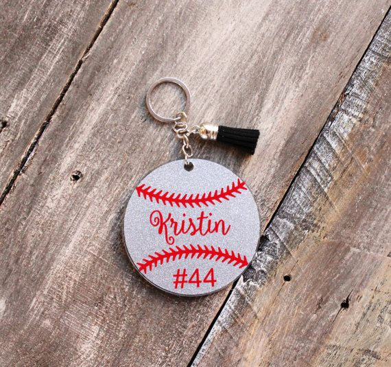 Softball season is coming up quickly and this would make a fantastic gift for your favorite softball player, coach, or even for the whole team for the end of the year banquet or senior gift! Does your team travel? This keychain is a great bag tag or luggage tag if you're going out of town! This is an acrylic softball key chain in a variety of colors personalized with your players name and number. You can pick traditional softball yellow or silver glitter softball and you can pick any color…