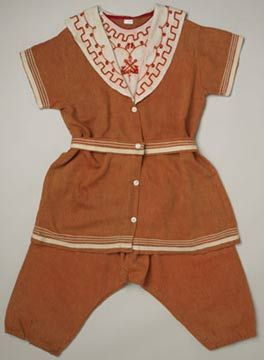 Embroidered red-orange wool serge bathing suit with wool braid trim, by LY and J Nathan, English (Liverpool), 1910. Worn by Emily Tinne during her honeymoon in Ireland. Matches the orange cotton sateen bathing cap and embroidered linen espadrilles.