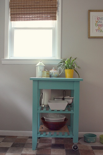 painted kitchen cart.  Wonder if I could do this with our tattered cheap cart?