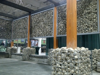 Designer Gabions. Use for planters, base supports and decorations, light supports, benches, garbage containers and more. The panels can be used for wind breaks, noise barriers, privacy panels, green walls for plants and vertical gardens as well as fences. In some cases they can be installed without digging and are virtually maintenance free. You can fill with whatever coloured stone or product that suits your decor. New for 2013, lighting and watering systems www.designergabions.com