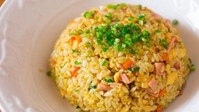 curry-fried-rice made with carrots, onions, ham, scallions, eggs, and seasonings