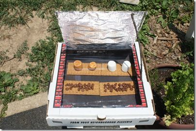 Smores in a solar oven....how fun would this be to do with the kids?  I'm so planning this for the summertime!