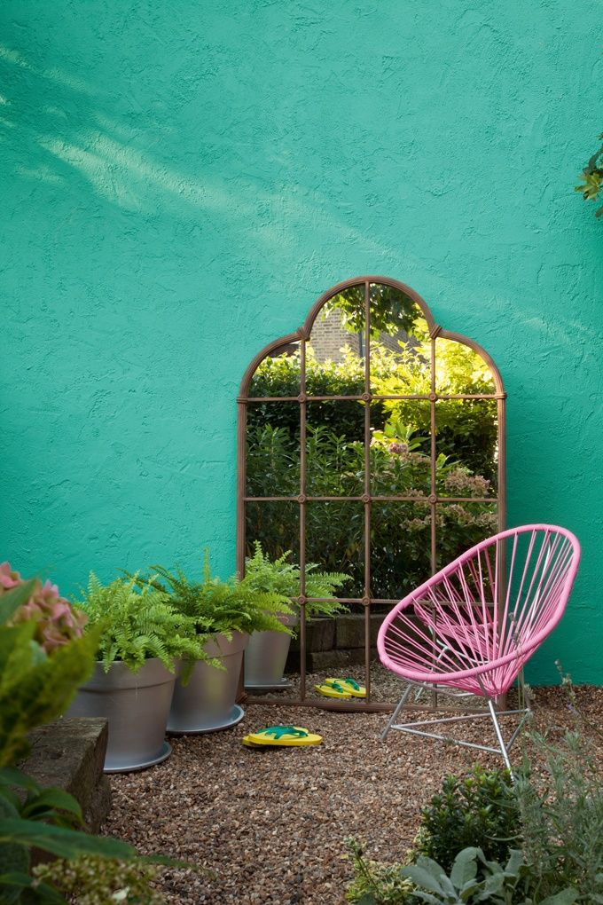 Outdoor mirror +  Pink Acapulco chair + turquoise wall