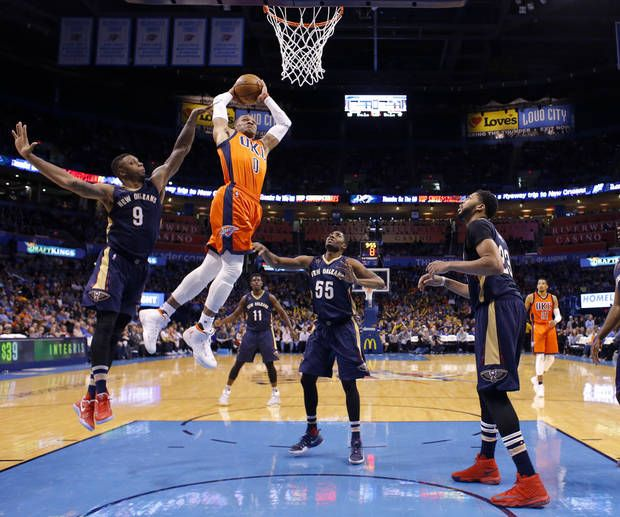 Oklahoma City's Russell Westbrook (0) goes up for a dunk in front of New Orleans' Terrence Jones (9), E'Twaun Moore (55) and Anthony Davis (23) during the NBA game between the Oklahoma City Thunder and the New Orleans Pelicans at the Chesapeake Energy Arena, Sunday, Dec. 4, 2016. Photo by Sarah Phipps, The Oklahoman