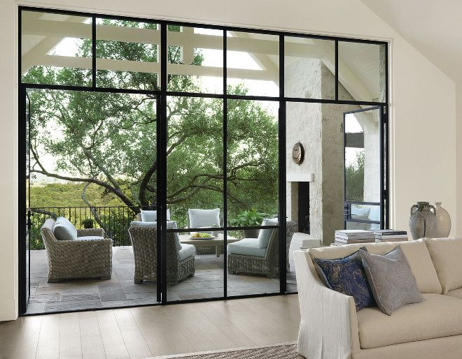 Gorgeous floor-to-ceiling black steel windows and doors to patio.