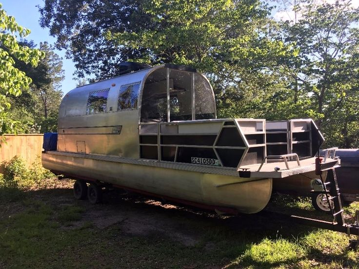 This vintage Airstream Sovereign was modified and put on a JC pontoon boat.