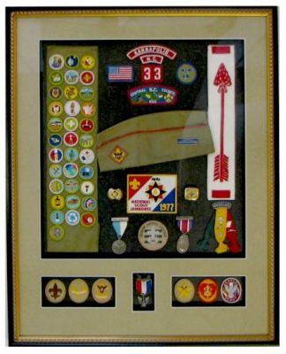 What an awesome way to display all those badges and achievements.  I totally love this idea for all my husbands badges.  Now to figure out where they are packed away.  Image only.