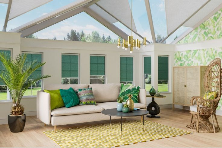 Totally Tropical trend. Botanical trend. Made-to-measure pleated blinds in Turquoise Crush from Apollo Blinds. Lush indoor paradise. Vibrant teal, turquoise and lime green colour inspiration for the home. Indoor greenery. Contemporary rattan conservatory furniture.
