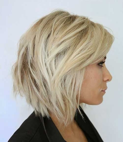 25 Short hairstyles that'll make you want to cut your hair. Love this blond angled bob. You could wear it straight or add some waves.