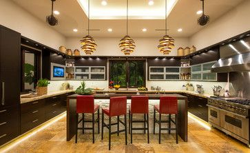 This is a stunning kitchen. Santa Cecelia granite is fairly common, but in this case, the lights are the stars of show. John Residence - tropical - kitchen - los angeles - d | studio