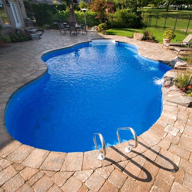 The deep blue liners pop with a grey red stone inground - How deep is the average swimming pool ...