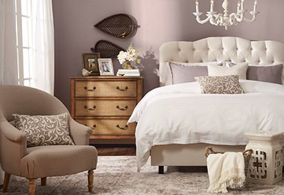 Romantic Neutrals and fluffy bedding create a feeling of calm. Textures and patterns provide interest.