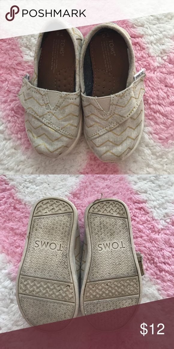 Toms (Chevron) Cream canvas with gold shimmery chevron detail. Super cute and only worn one time on a zoo trip. TOMS Shoes