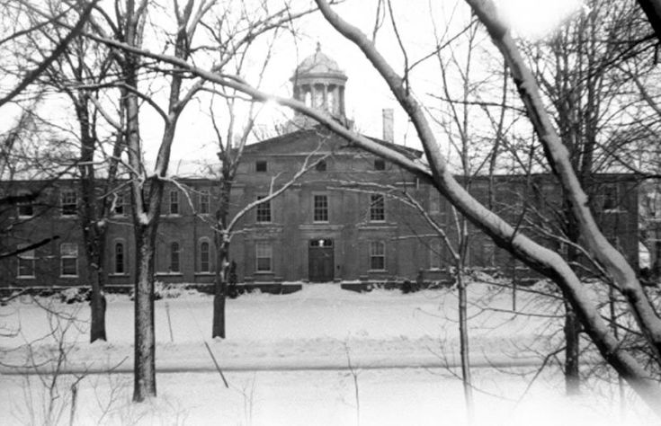 Ontario County Courthouse, 1964, A2013_006_001A. Photographer Brenton Lamb. A black and white photograph of the Ontario County Courthouse in the winter of 1964. View shows the front of the courthouse.